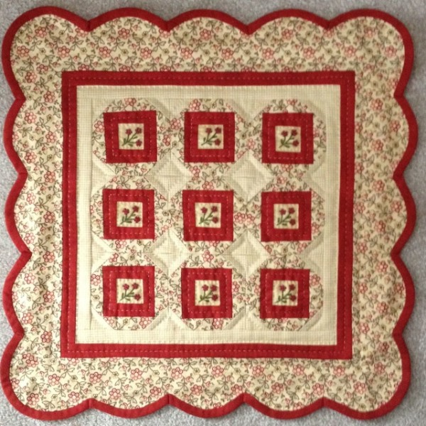 "Little Red Ten is 16"" x 16"" and has those cute little red flower buttons in the center of each block. The buttons are included in the pattern. The kit includes the fabrics for the top, back, and binding along with the pattern"